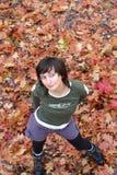 Curious girl. Standing in a garden in autumn Stock Photos