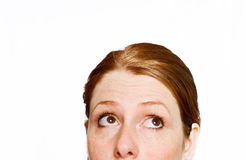 Curious girl. Curious red hair girl on white isolated background stock photography