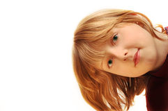 Curious girl. A pretty blond on white background royalty free stock image
