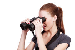 Curious girl with binoculars Stock Photography