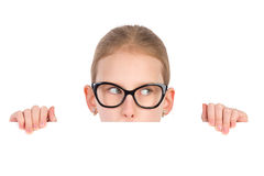 Curious girl in black glasses behind white placard Stock Photography
