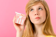 Curious girl holding unopened present Royalty Free Stock Photography