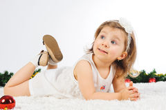 Curious Girl. Laying on puffy carpet Royalty Free Stock Photography