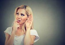 Curious girl listening to gossip stock photos