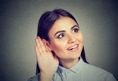 Curious girl listening to rumors royalty free stock photography