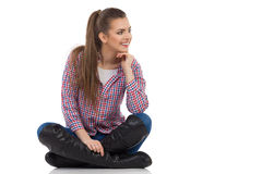Curious Girl Sitting Legs Crossed Stock Image