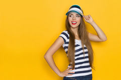 Curious Girl In Striped Shirt And Sun Visor Royalty Free Stock Photography