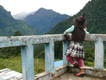 Curious girl on terrace looking to the Marsyangdi valley Stock Photo