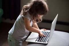 Curious girl using laptop, pc control security for kid concept Royalty Free Stock Images