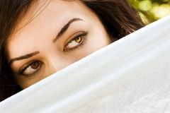 Curious green eyed woman Royalty Free Stock Image