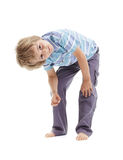 Curious and intrigued boy bending over Stock Images