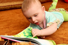 Baby with a Book Stock Photo
