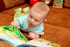 Baby with a Book Royalty Free Stock Photos
