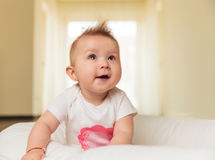 Curious little baby girl is looking up royalty free stock image
