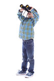 Curious little boy is looking left up through binoculars Stock Photography