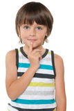 Curious little boy in a striped shirt Stock Image