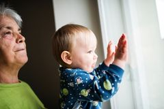 Curious little boy watching on the window Royalty Free Stock Photo