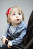 Curious little girl looking at parents Royalty Free Stock Image