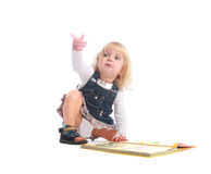 Curious little girl pointing her finger up Stock Photo