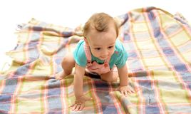 A curious little one. Cute baby crawling on floor. Smiling small kid. Early childhood development. Happy little child stock image