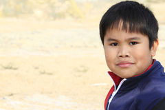 Curious looking young asian boy Royalty Free Stock Photo