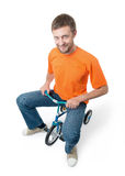 Curious man on a children's bicycle on white Stock Photo