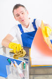 Curious man cleaner at the office Royalty Free Stock Photography