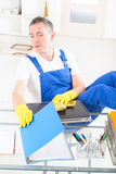 Curious man cleaner at the office Royalty Free Stock Photos
