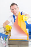 Curious man cleaner at the office Royalty Free Stock Images