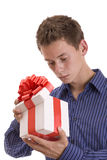 Curious man with gift Stock Image