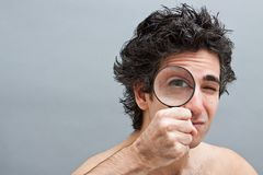 Curious man with magnifier Royalty Free Stock Photography