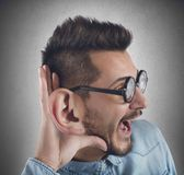 Curious man. Nerd man listens with curiosity a gossip royalty free stock images