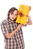 Curious man with present Royalty Free Stock Photos