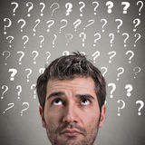 Curious man thinking looking up has many questions Royalty Free Stock Images