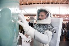 Interested spaceman in new place Royalty Free Stock Images