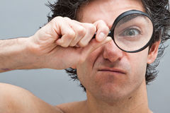 Curious Man With Magnifier Stock Photo