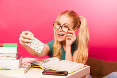Curious, naughty, playful schoolgirl with hairstyle as Pippi Lon Stock Photo