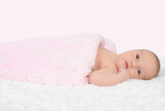 Curious newborn baby girl laying on back. isolated Stock Photography