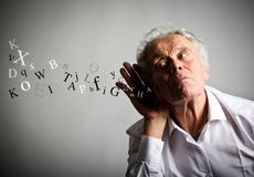 Curious old man in white and letters. Royalty Free Stock Photos