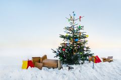 Curious open air christmas tree in the snow. Decorated with sausages, balloons, toilet brushes and clothespins Royalty Free Stock Images