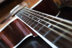 Guitar. Curious point of view of a guitar Royalty Free Stock Image