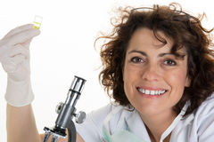 Curious research scientist in lab coat and rubber gloves Royalty Free Stock Image