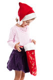 Curious Santa girl isolated on white background Royalty Free Stock Images