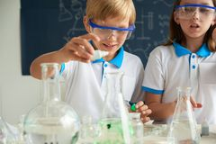 Studying chemistry Royalty Free Stock Images