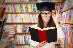 Curious School Student Reading a Book in a Library Royalty Free Stock Photos
