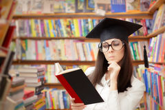 Curious School Student Reading a Book in a Library Stock Images