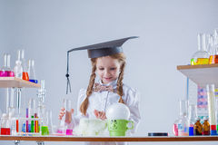 Curious schoolgirl conducting experiment in lab Royalty Free Stock Photography
