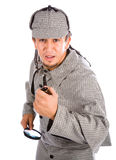 Curious Sherlock Holmes pipe and magnifying glass Royalty Free Stock Photo