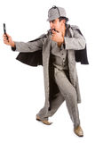 Curious Sherlock Holmes pipe and magnifying glass Royalty Free Stock Image