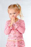Curious shy little girl Stock Photo